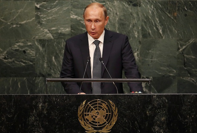 Russian President Vladimir Putin addresses attendees during the 70th session of the United Nations General Assembly at the U.N. Headquarters in New York