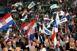 Supporters of Croatian Democratic Union (HDZ) wave national and HDZ flags during an election rally at Arena in Zagreb