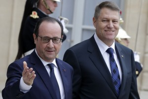 French President Francois Hollande welcomes Romanian President Klaus Iohannis at the Elysee Palace in Paris